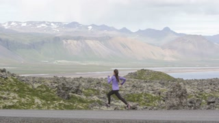 running imagewoman-exercising-runner-athlete-training-on-road-fit-female-sport-fitness-model-training-jogging-outdoors-living-healthy-lifestyle-in-beautiful-mountain-nature-iceland-slow-